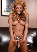 Smoking hot chocolate transsexual Natalia Coxxx posing