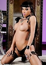 Beautiful Adriana strips in tempting stockings