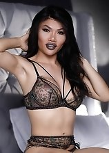 Xena Lynn the hot oriental t-girl with a huge dick pleasures herself until she cums hard