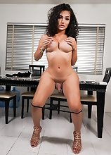 Watch Kimmie Bombshell posing, stroking her cock and fucking her tight ass with her glass dildo!