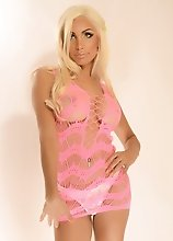 Sassy blonde TS ANGELES CID stripping from her pink dress