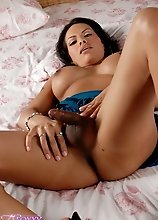 Naughty TS Foxxy posing sexy in bed